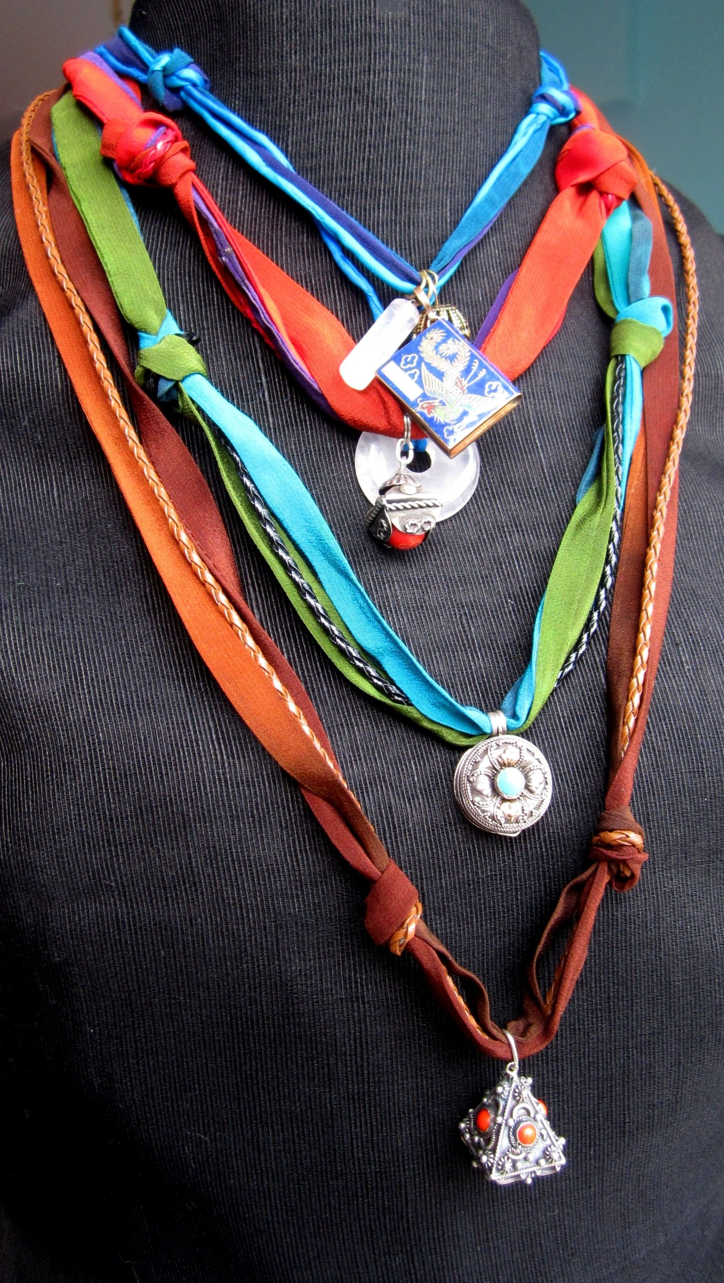 Dyed Silks and leather necklaces,with antique pendants