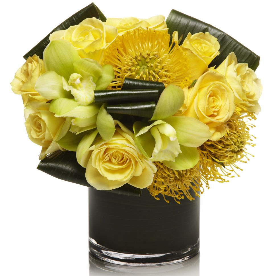 yellow roses, yellow pincushions and green cymbidiums Corporate flowers, corporate flower centerpiece, add pic source on comment and we will update it. www.myfloweraffair.com can create this beautiful flower look.