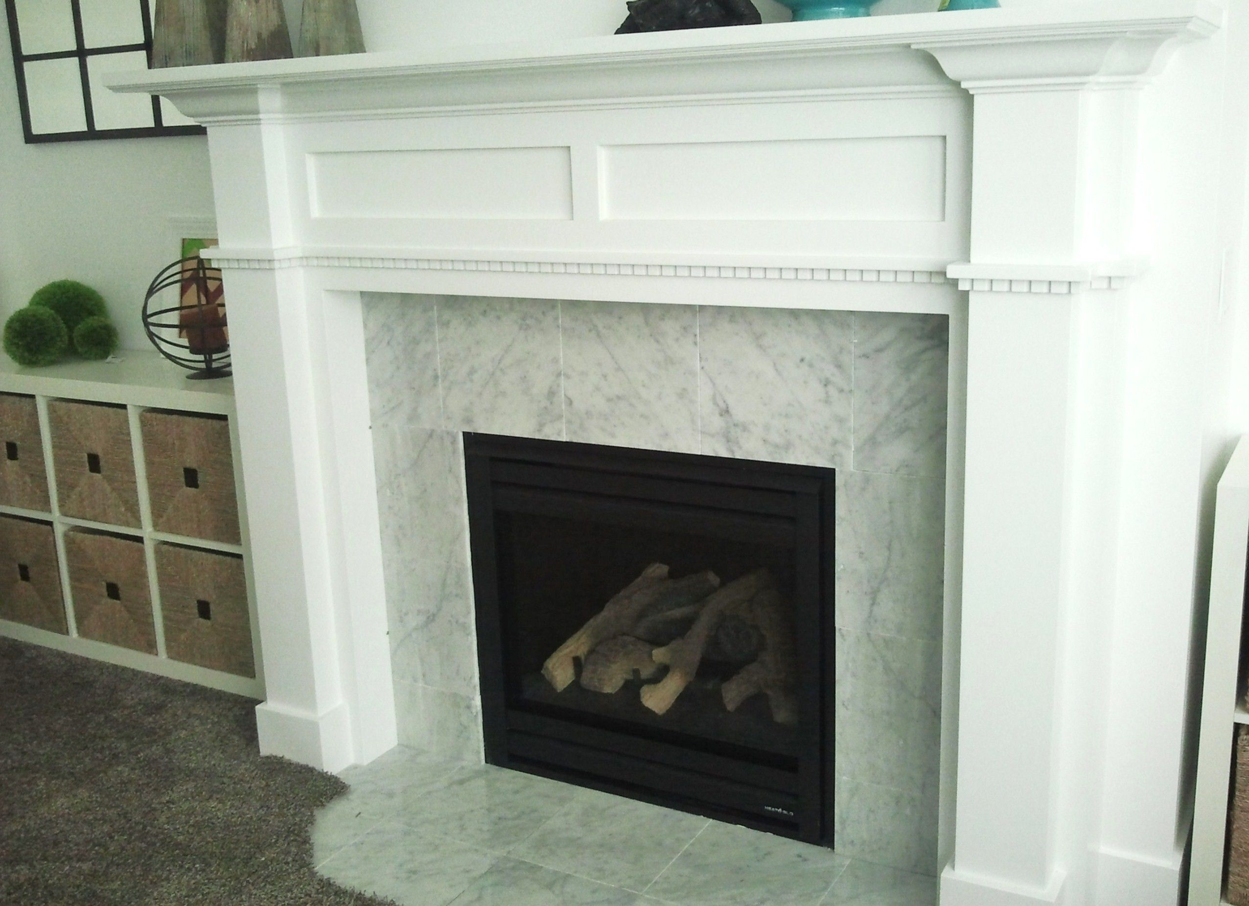 Modern Fireplace Design With Green Marble Surround And White