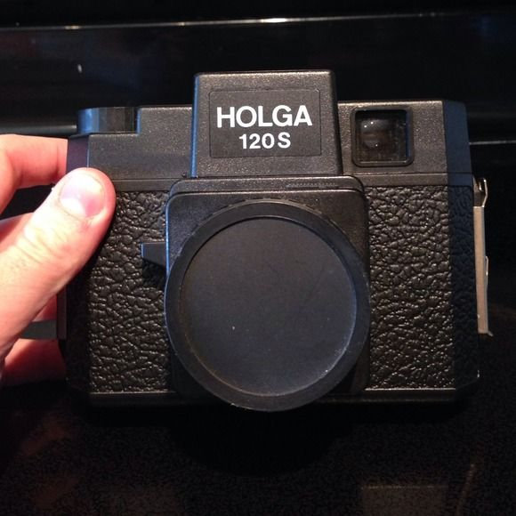 Holga 120s plastic camera lomography holga The format arrow on the back of the camera easily slides between 12 and 16 exposures Zone focus system Mostly plastic, including the lens; extremely small and compact one-piece plastic molded body uses 120 film holga Accessories