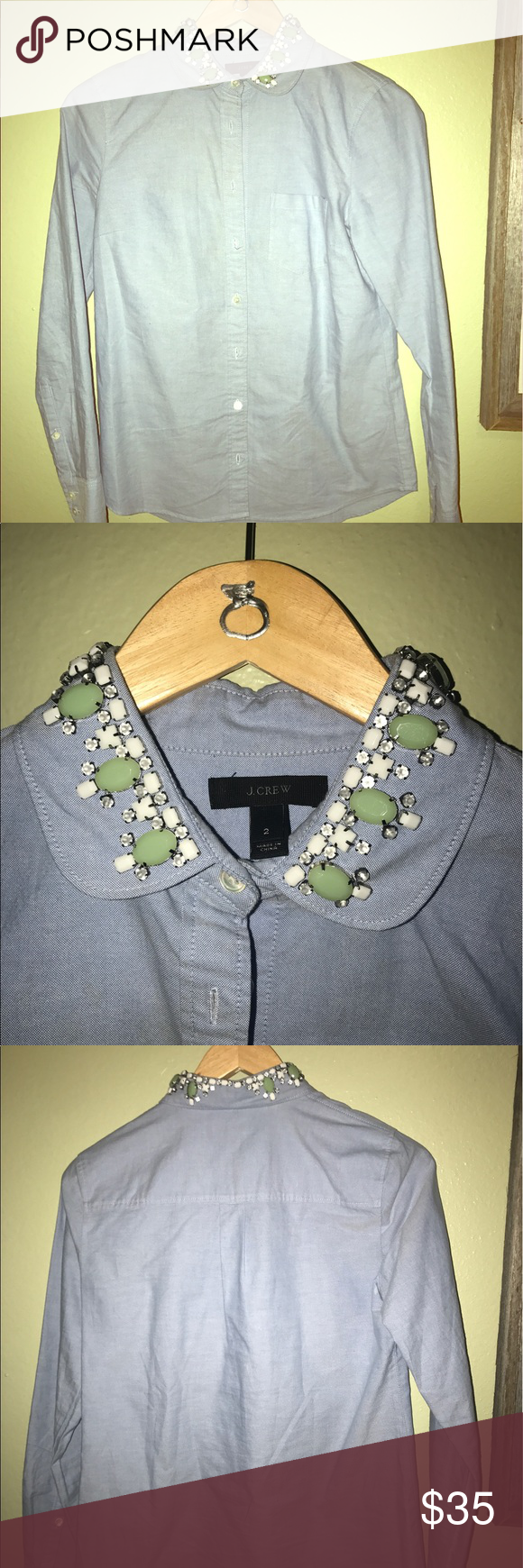 J. Crew chambray blue button down with gemstones Amazing condition J. Crew chambray, blue button down with gemstones. All in place. Size. 2 J. Crew Tops Button Down Shirts