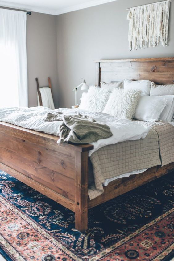 Cozy Reclaimed Wood Bed Faux Fur Pillows Colorful Rug Macrame Dream Space Home Bedroom Bedroom Inspirations Home Decor Bedroom