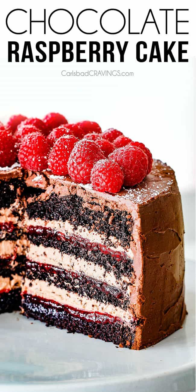 Chocolate Raspberry Cake with sliced removed showing layers of dark chocolate cake, raspberry jam filling, chocolate ganache and chocolate mousse #chocolatecake