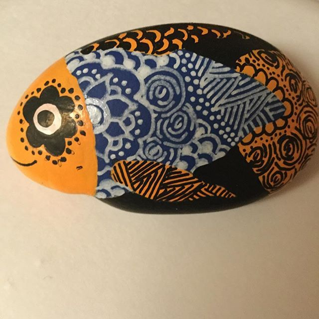 A orange and blue zentangle fish  this was very fun to do and I think he turned out great  read my bio and follow @artproductions123 for more #art #paintedrock #paintedrocks #zentangle #zentangles  #fish