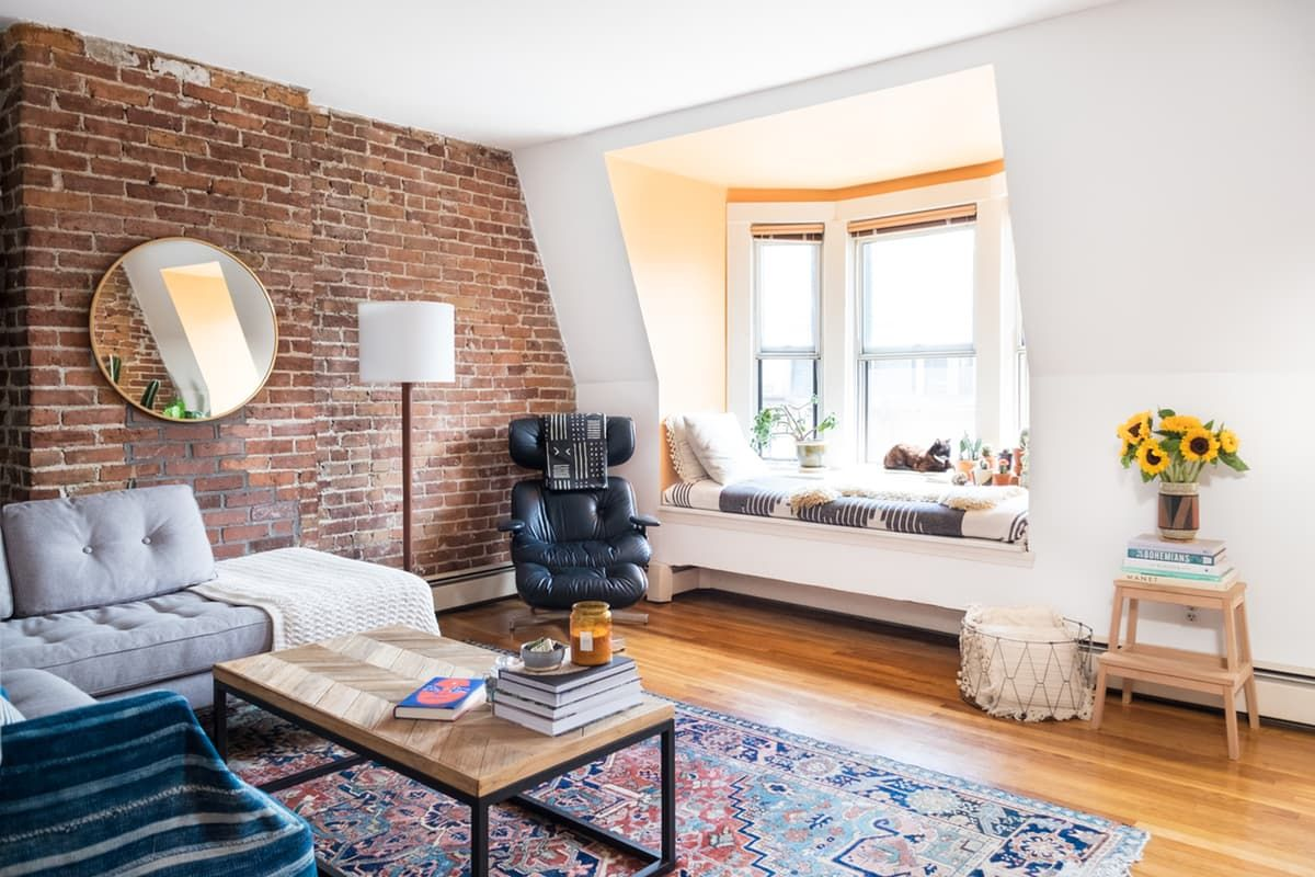 Living room in a Boston apartment with exposed brick ...