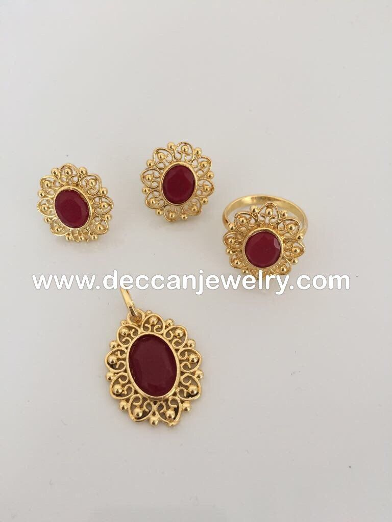 Sajal faux ruby pendant earrings and finger ring set pendents