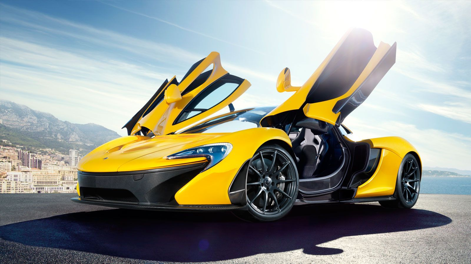 Let The Sun Shine In Mclaren Formula 1 The Mclaren P1 Borne Out Of 50 Years Racing Experience Super Sport Cars Sports Car Car Wallpapers