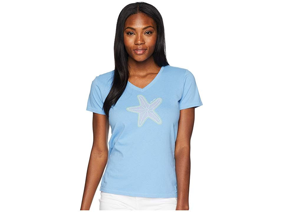 Life is Good Mosaic Star Crusher Vee Tee (Powder Blue) Women's T Shirt. Slowly scoot your way to a nearby food source just like your favorite echinoderm with this Life is Good Mosaic Star Crusher Vee Tee. Classic Fit barely skims the body for a flattering silhouette. Breathable cotton is garment washed for that lightly worn  favorite shirt feel. Double-needle stitching increases durability. V-neckline. Short-sleeve coverage. C #LifeisGood #Apparel #Top #TShirt #Blue