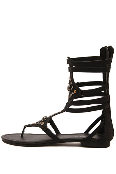Black Studded Strappy Thong Gladiator Sandals  The casual gladiator sandals feature faux leather material, chic thong pose, snake print detail, studded decor front, strappy cutout design, back zipper closure. Wear these wedges with your favorite sun dress for a chic look.