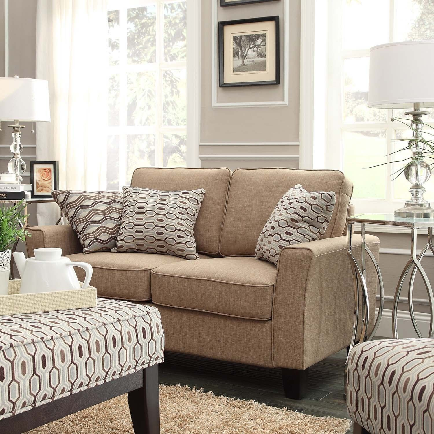 Extra deep seat cushions with wide arms provide relaxed and comfortable  seating to this track-