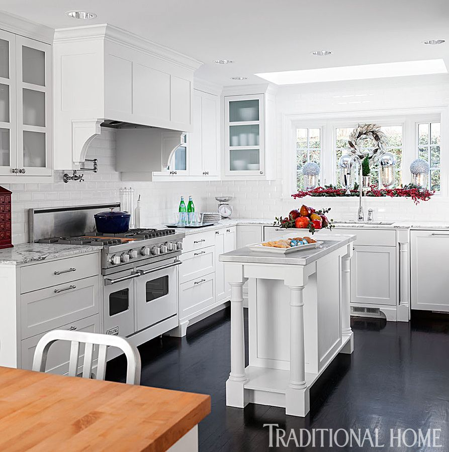 White-painted custom cabinets and an expanse of beveled white subway ...