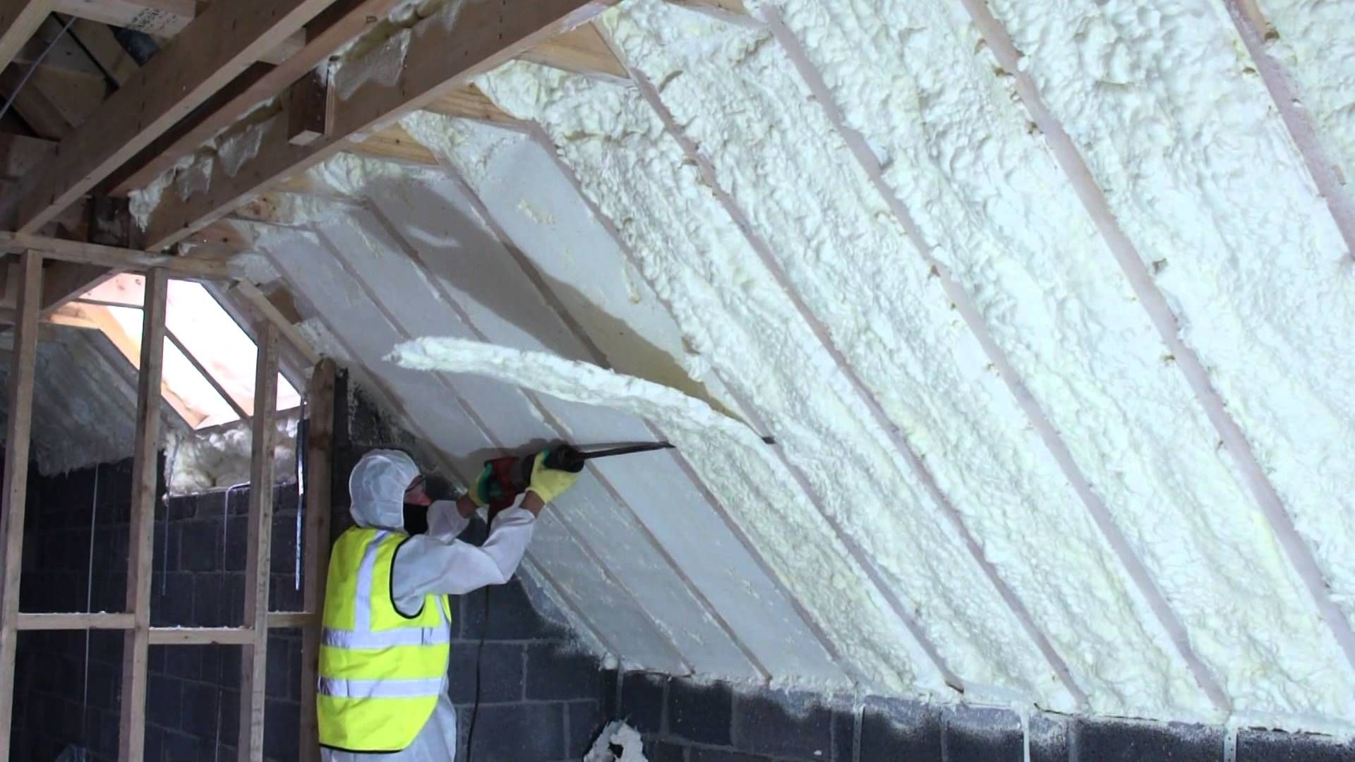 Spray foam of attic using fusion sprayfoam insulation being cut spray foam of attic using fusion sprayfoam insulation being cut flush ww solutioingenieria Images