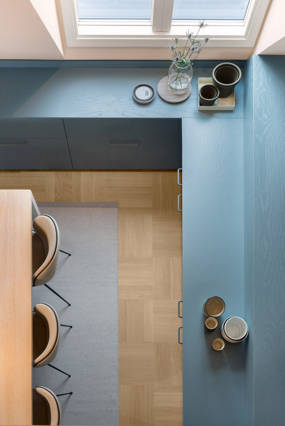 Minimalist scandinavian dining room in this swedish apartment renovated by note design studio spectacular blue cabinetry pair well with ever so slightly