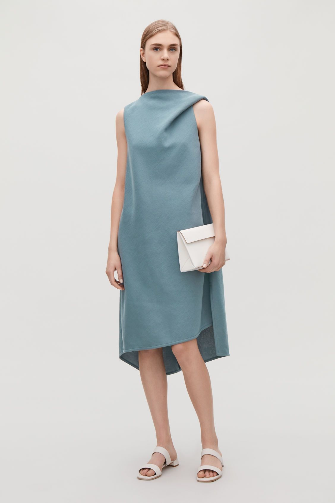 Cos green dress 2018  Model front image of Cos jersey dress with draped shoulders in blue