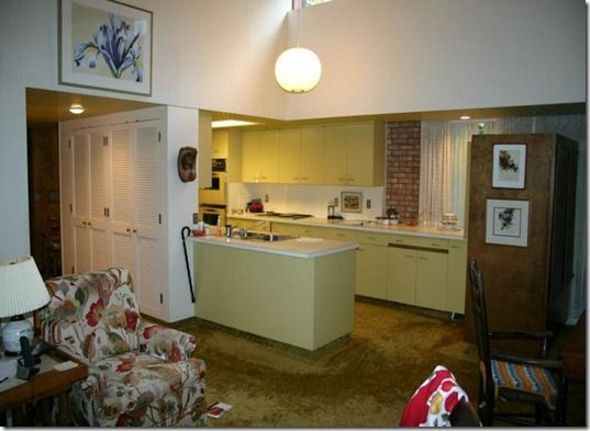 Time Capsule home in Midland, MI. Love the yellow metal kitchen!