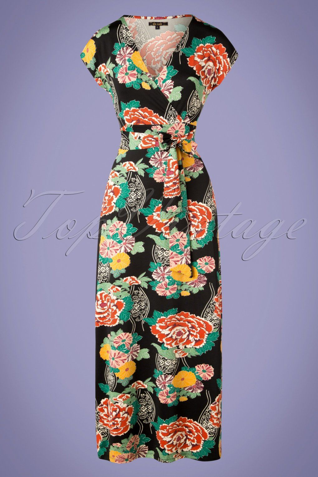 6515a243a9cc97 This 70s Lot Mai Tai Maxi Dress in Black is a playful yet elegant dress!