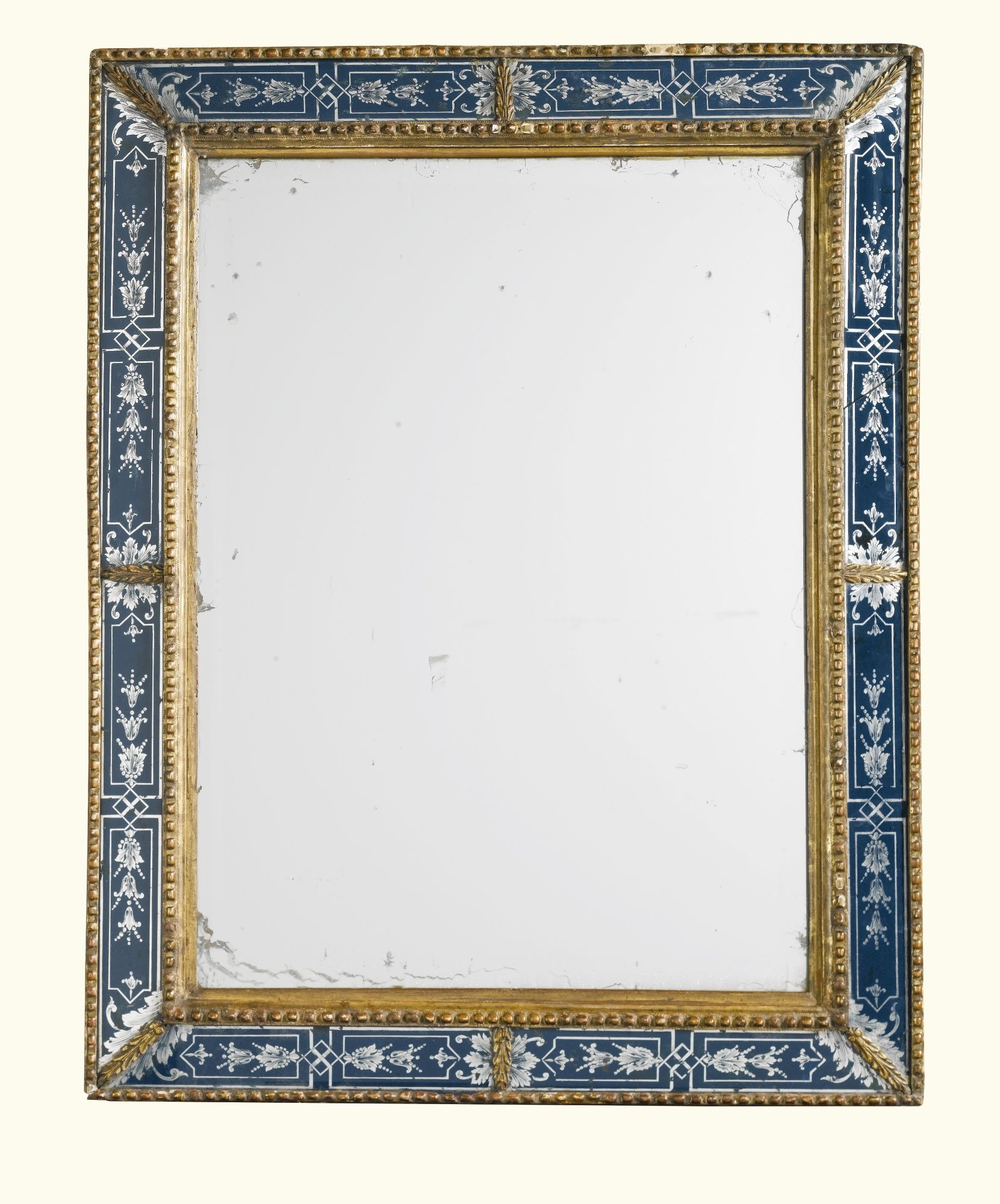 A Queen Anne style carved giltwood verre églomisé mirror, early 20th century, probably by Lenygon & Co