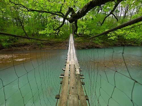 Swinging footbridge over the Mulberry River near Catalpa & Oark, Johnson County, Arkansas ~ photographer Tim Ernst  #South #Southern