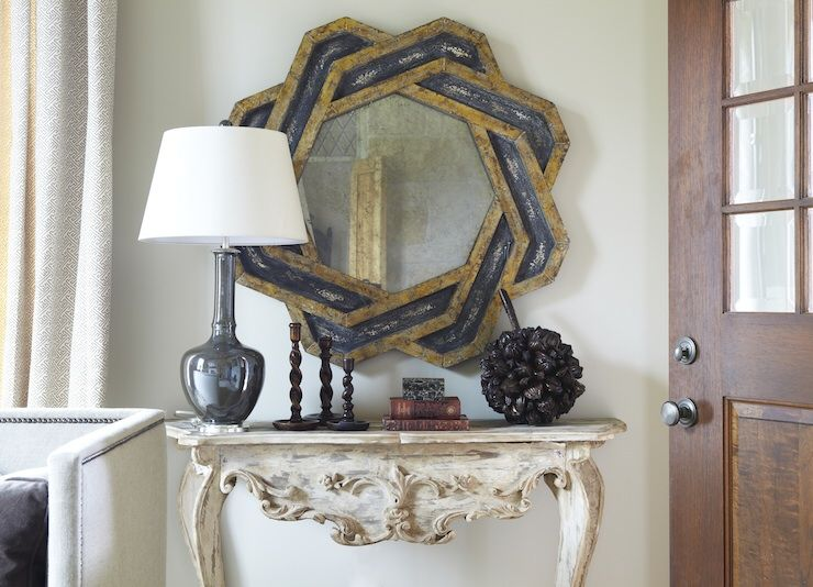 This Entrance Has A Beautiful Carved Wood Console Table