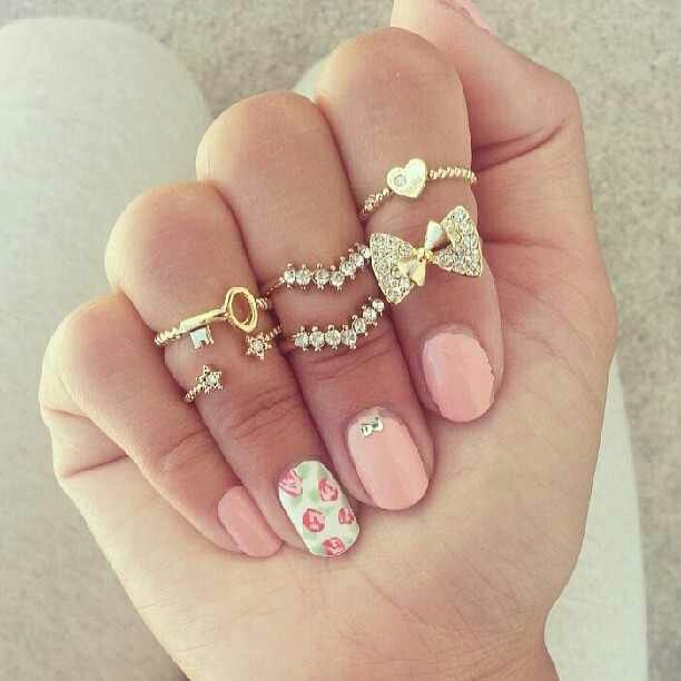 Floral nails with gold rings.
