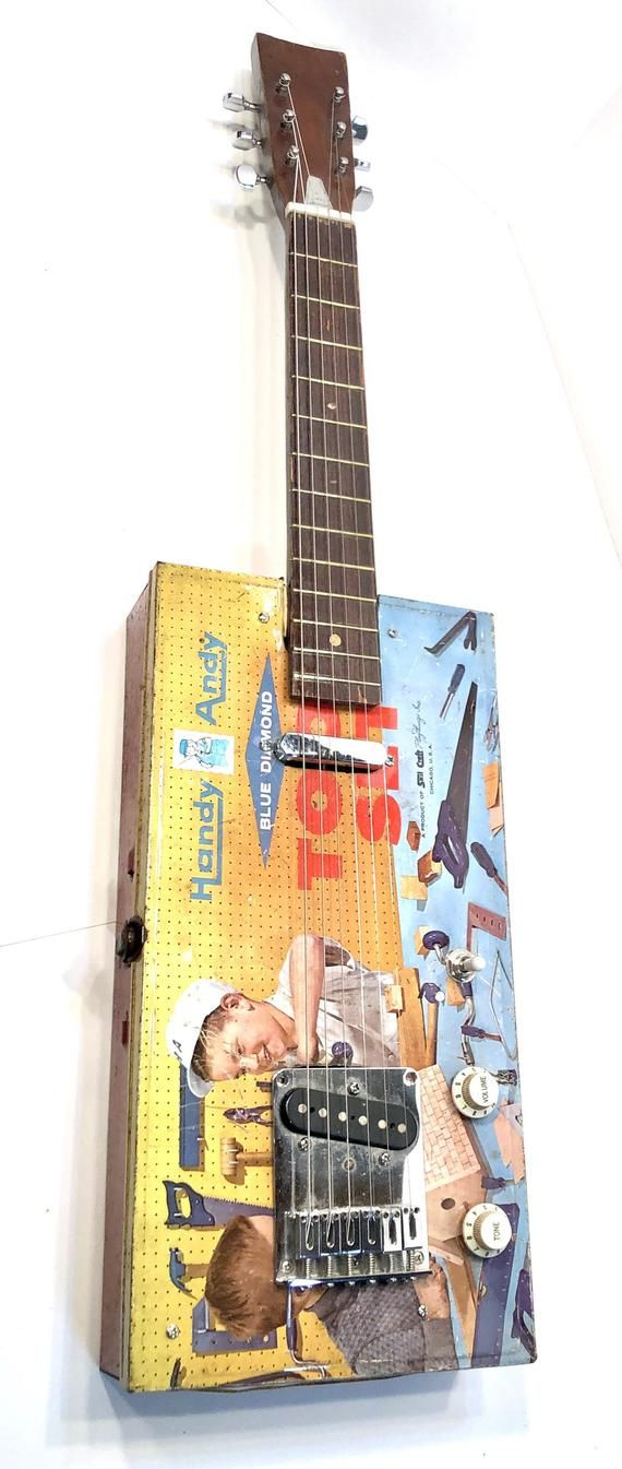 Cute Junky Hammered Handy Andy Vintage Guitar made out of an old toolbox because who the hell knows why #vintageguitars