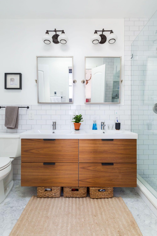 Clean White Subway Tile Matte Black Lighting Fixtures And A Warm Wood Vanity Combine In This Bathr Floating Bathroom Vanities Bathroom Trends Bathroom Vanity