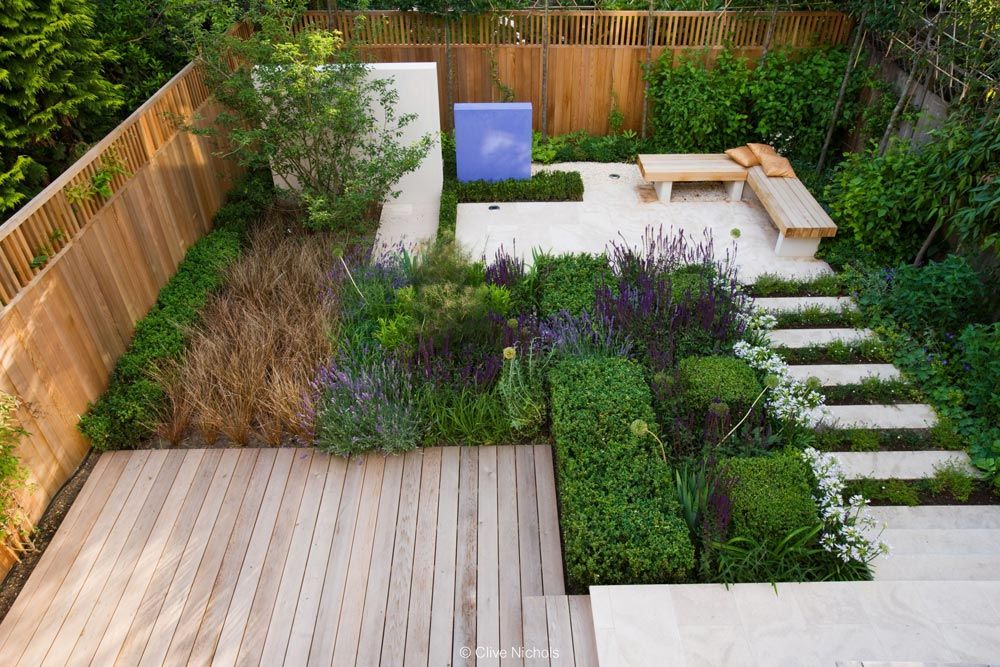 Garden By Design a curved deck links the seating area to the house asian garden by lush garden Reflection Garden By Charlotte Rowe