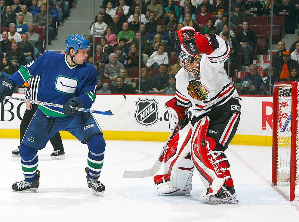 Taylor Pyatt Of The Vancouver Canucks Looks On As Patrick Lalime Of The Chicago Blackhawks Makes A Save With His Mask On F Vancouver Canucks Hockey Fans Goalie