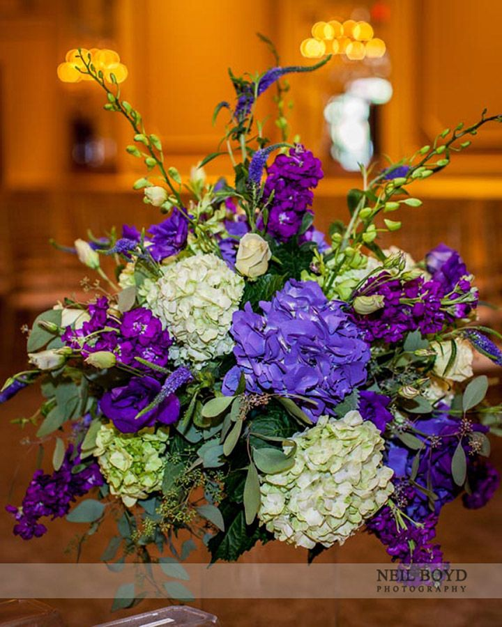 Purple and green wedding flower centerpiece