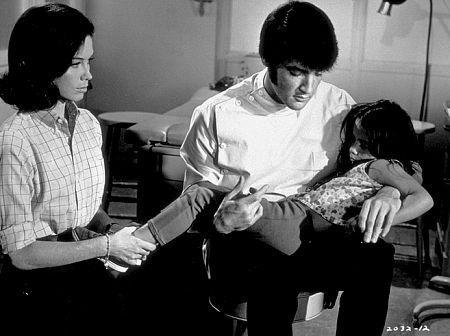 """Elvis Presley, Mary Tyler Moore, and Lorena Kirk in """"Change of Habit,"""" Universal, 1969."""
