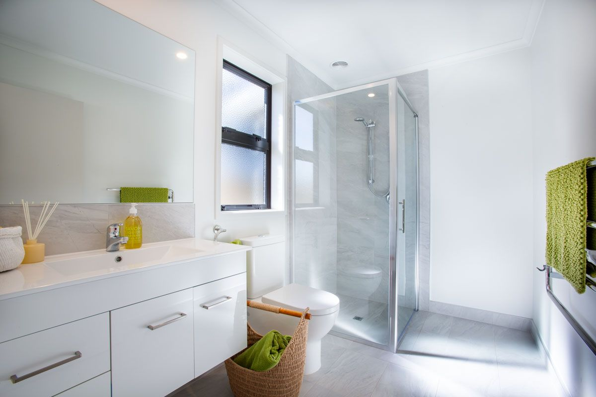 Gorgeous White Ensuite With Lime Green Accessories Bathroom