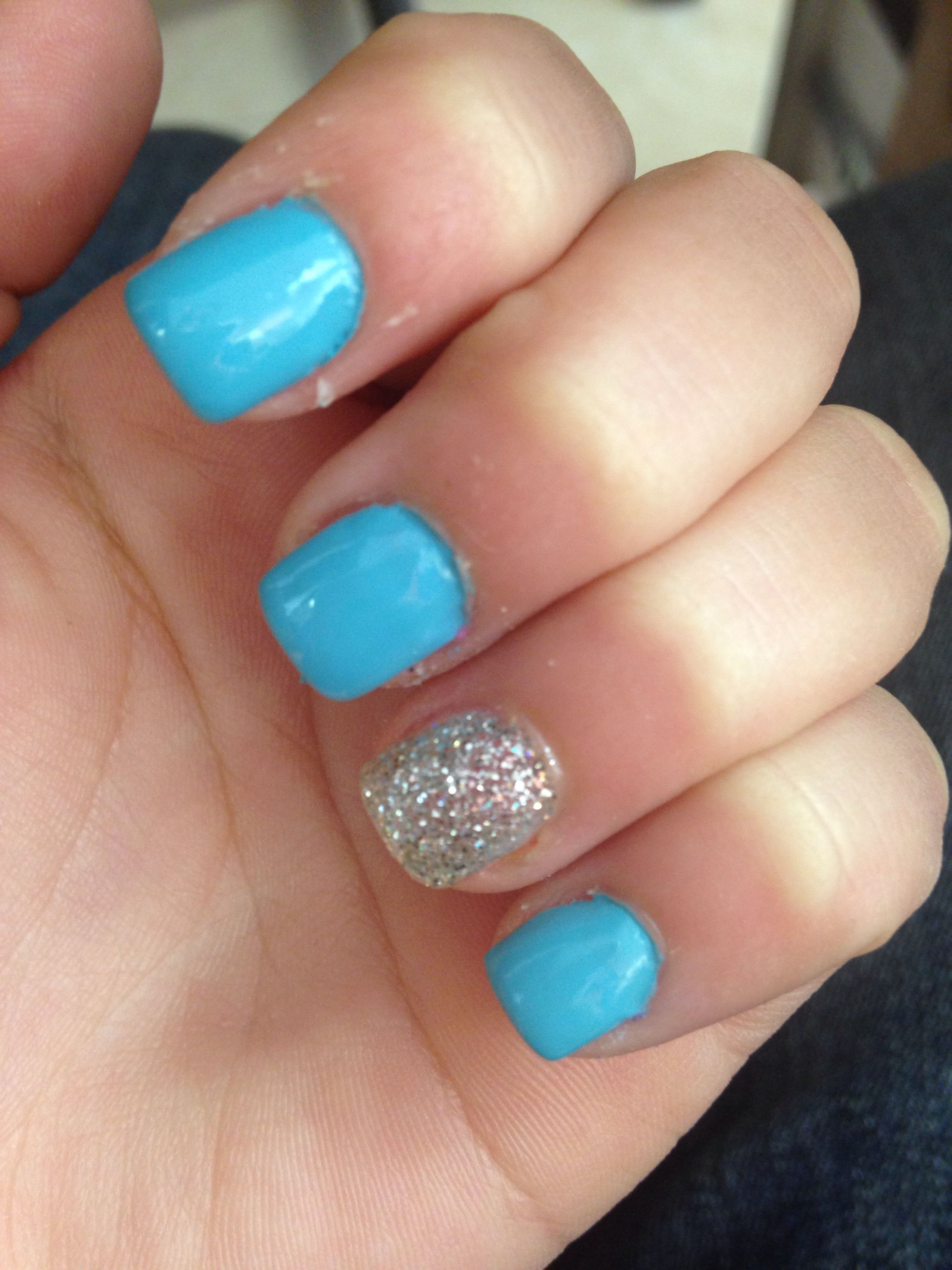 Beautiful light blue with sparkle accent acrylic nails! Love
