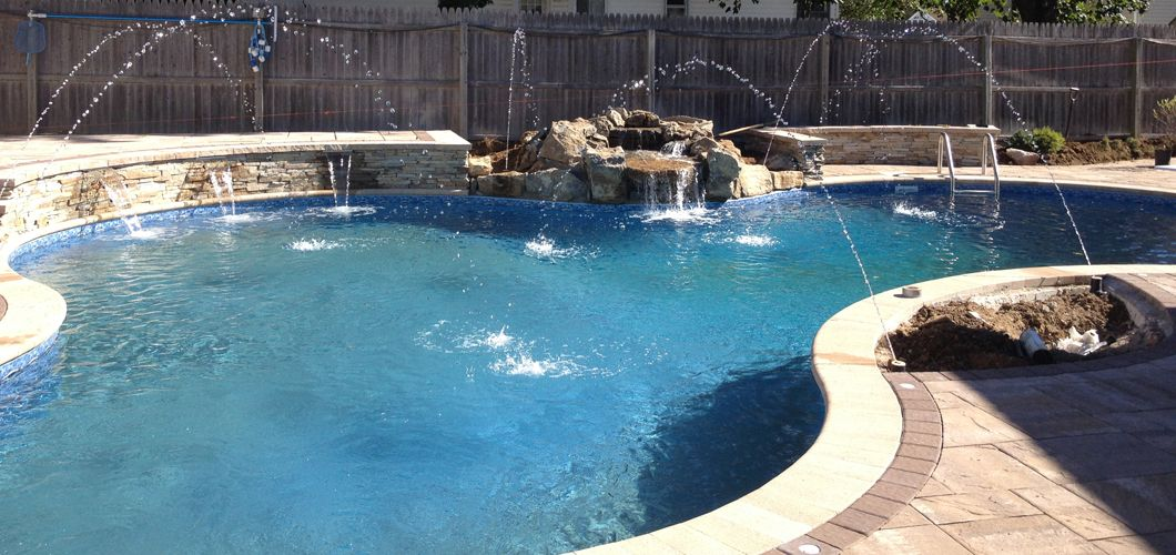 Freeform pool design with deck jets, natural waterfall, Sheer ...