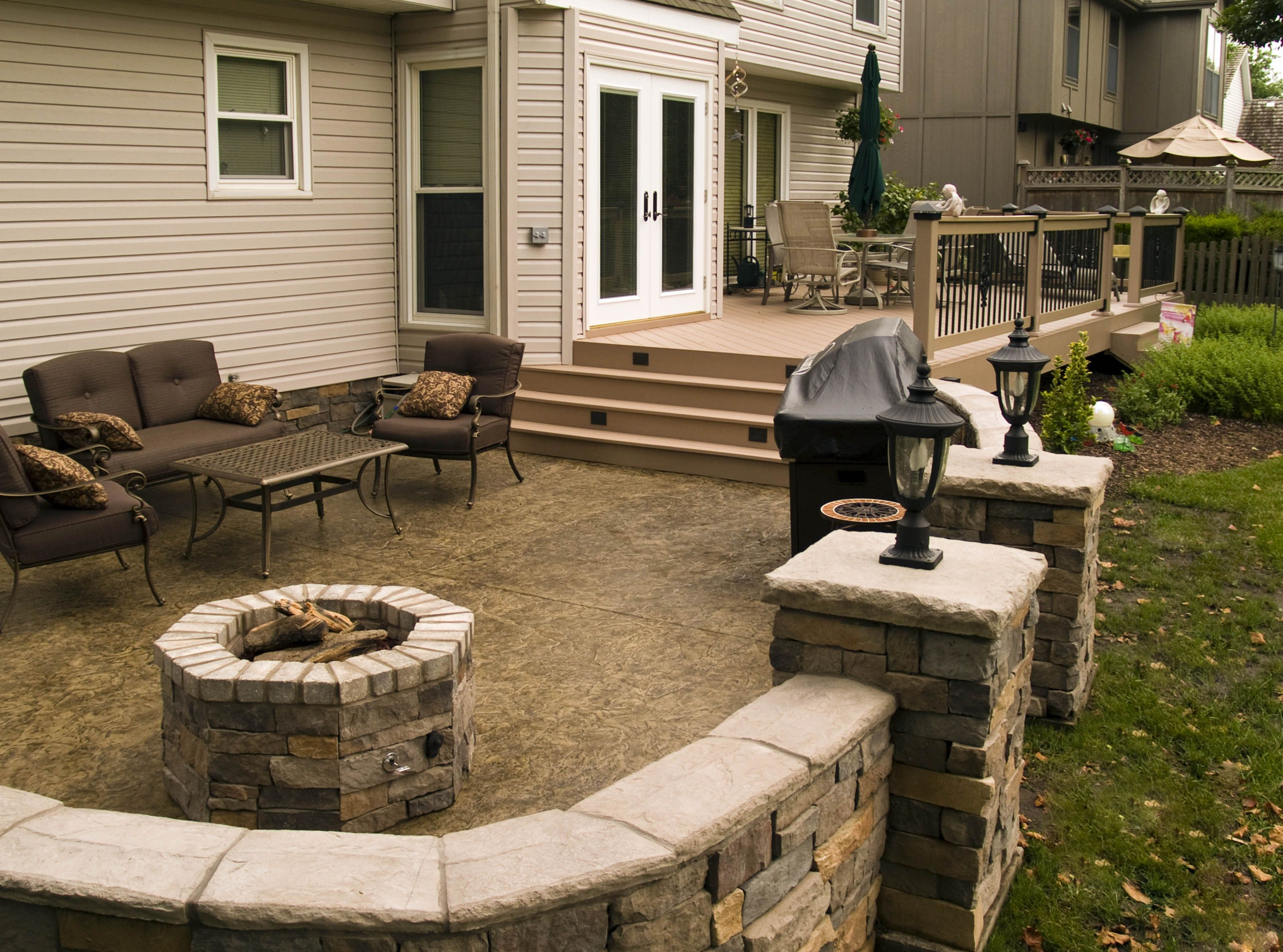 Azek Deck Stamped Patio Stone Walls Lighting and Fire Pit in