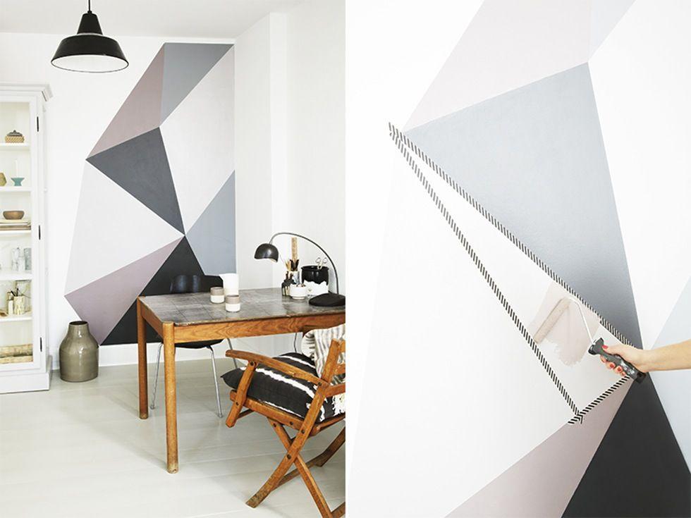 La hjemmekontoret bli boligens mest inspirerende sted med grafisk kunst på en av veggene.