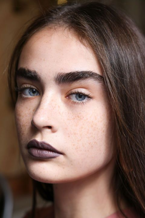 The lipstick at Acne Studio's spring 2017 show was gray, purple, and metallic. Makeup artist Aaron de May used MAC Cosmetics Deep Rooted Lipstick to start, then layered on different eyeshadows to get the metallic effect.