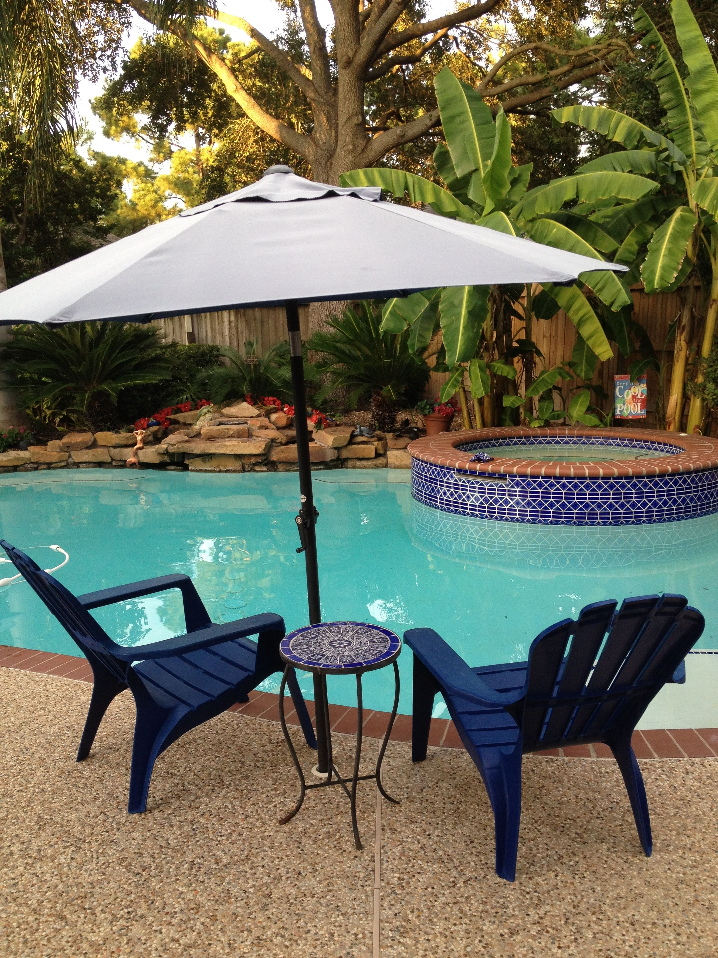 stick a patio umbrella in the hole for a pool volleyball net you