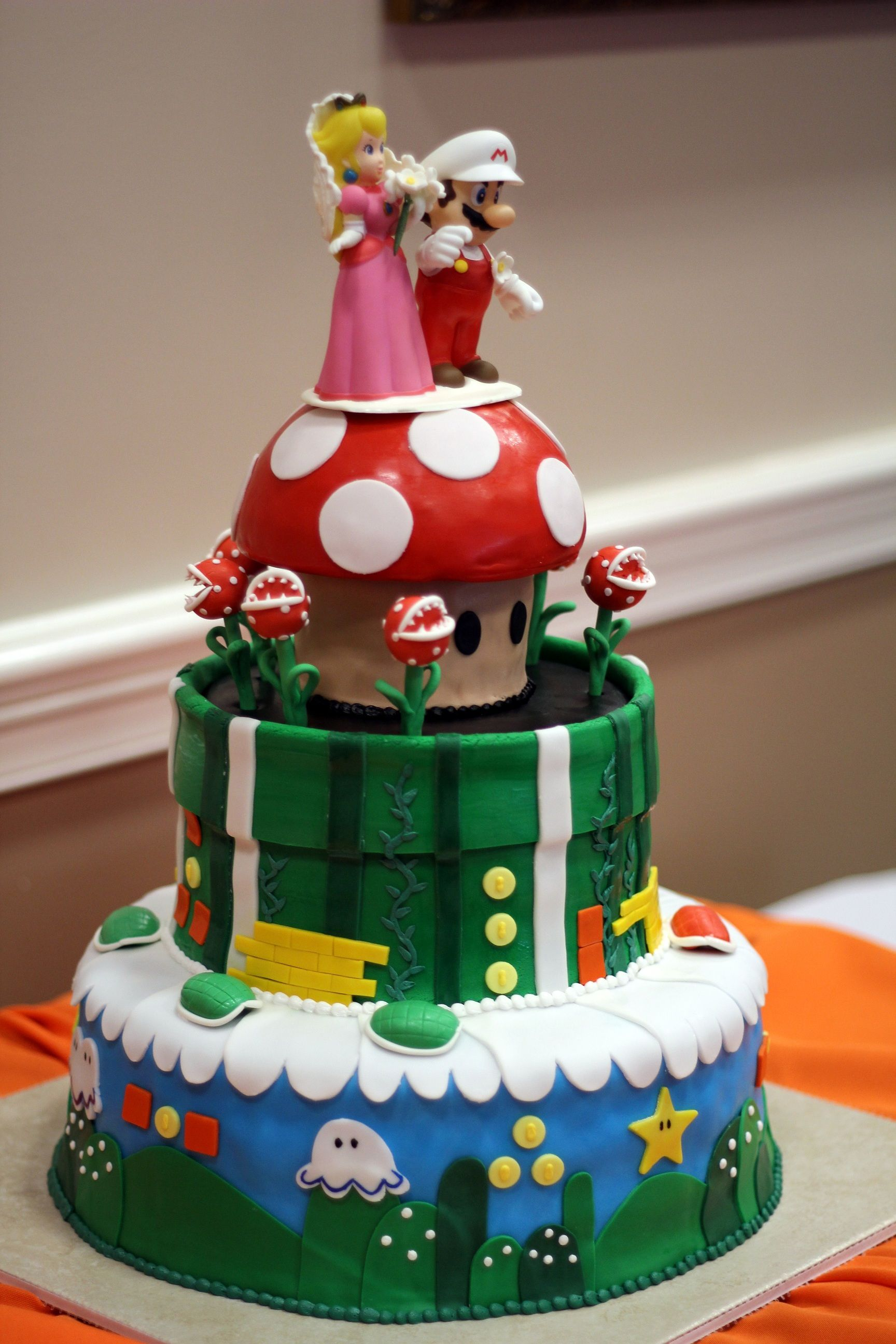 fun mario cake from kelsey and michael s wedding at ten oaks
