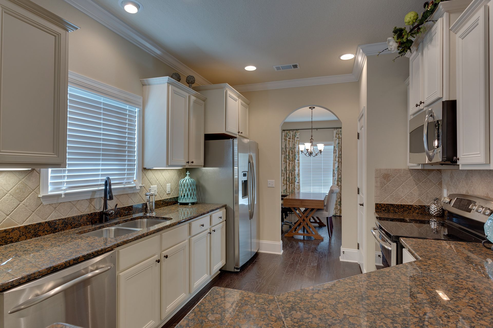 """This """"Alabaster"""" floor plan #kitchen is bright and cozy ..."""