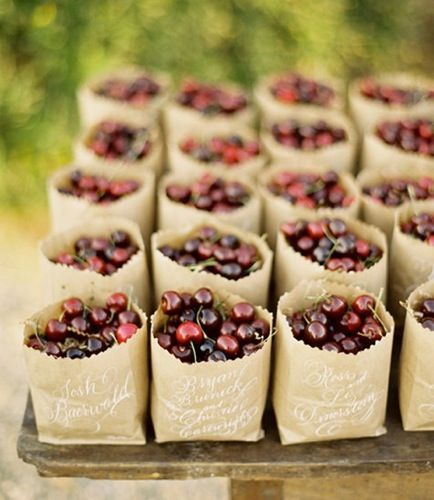 great idea for @Tara Farquhar: kraft bags. white calligraphy, filled with bold cherries. guest snack after the ceremony?