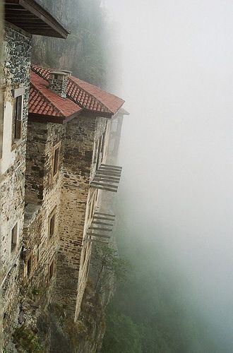 Sumela Monastery in Turkey:  built around a cave, hanging over a precipice