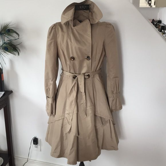 Bebe Trench Coat Bebe Trench Coat with an adorable layered skirt. It also has a leopard lining inside. bebe Jackets & Coats Trench Coats