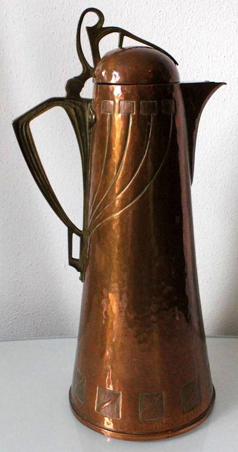 WMF hammered copper Art Nouveau flagon with cast brass fittings, 15