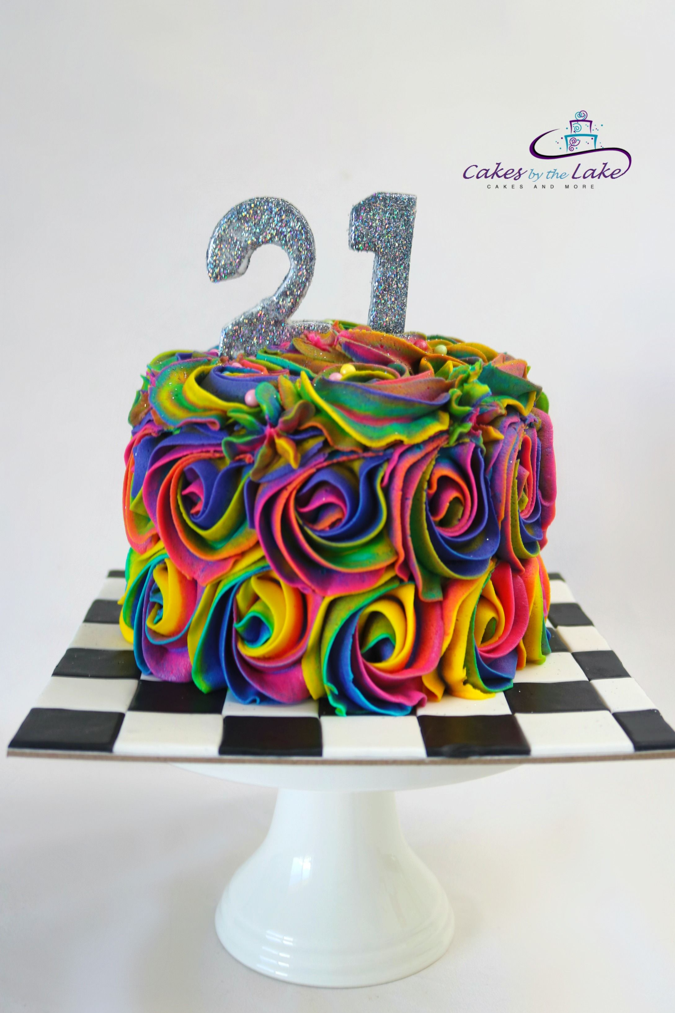 RAINBOW ROSETTE 21ST CAKE We love the bright colours of our rainbow rosettes, and this butter cake finished with rosettes, a checkerboard base and sparkling '21' is certainly full of colour. www.cakesbythelake.com.au  www.instagram.com/cakes_by_the_lake