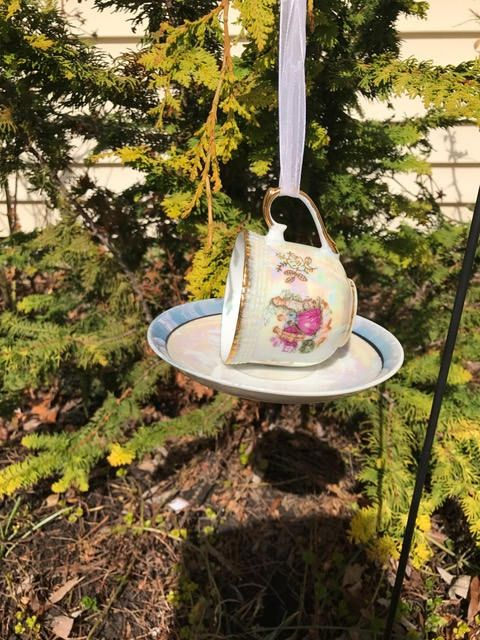 hanging birdfeeder made from vintage teacup and saucer by EviesElegantWhimsies on Etsy
