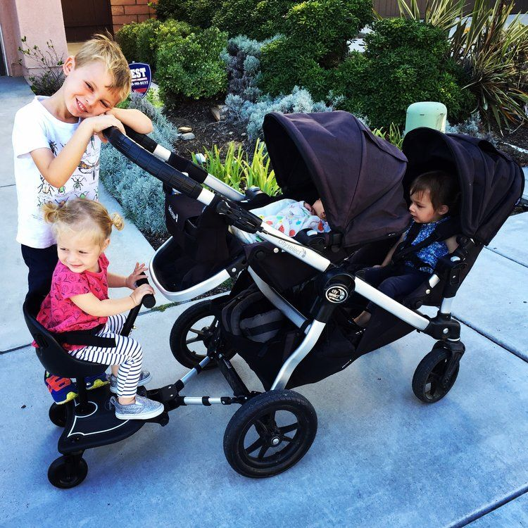 This Universal Stroller Attachment Gets Three Kids on Your
