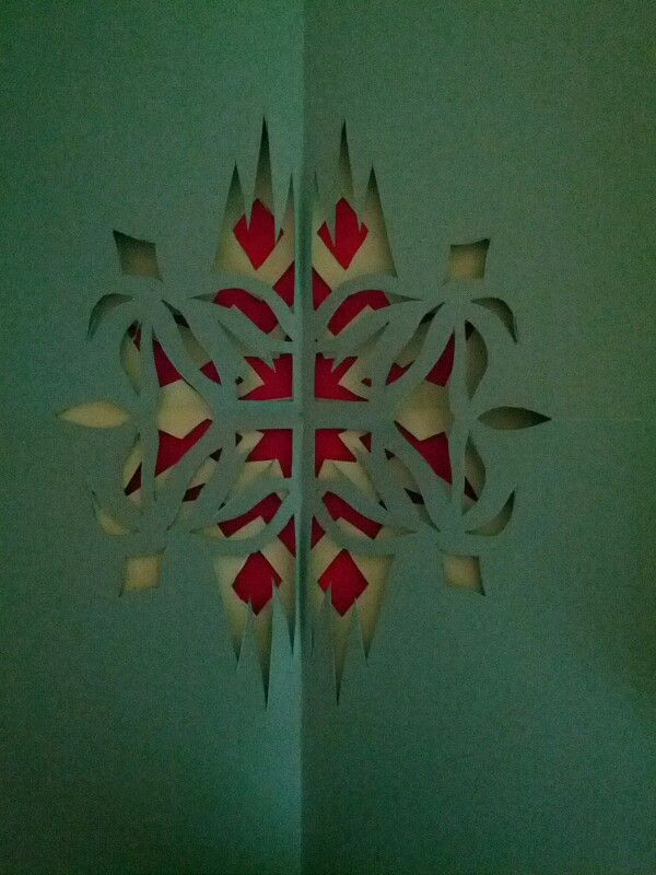 Paper sculpture.  Red, light green, and green.