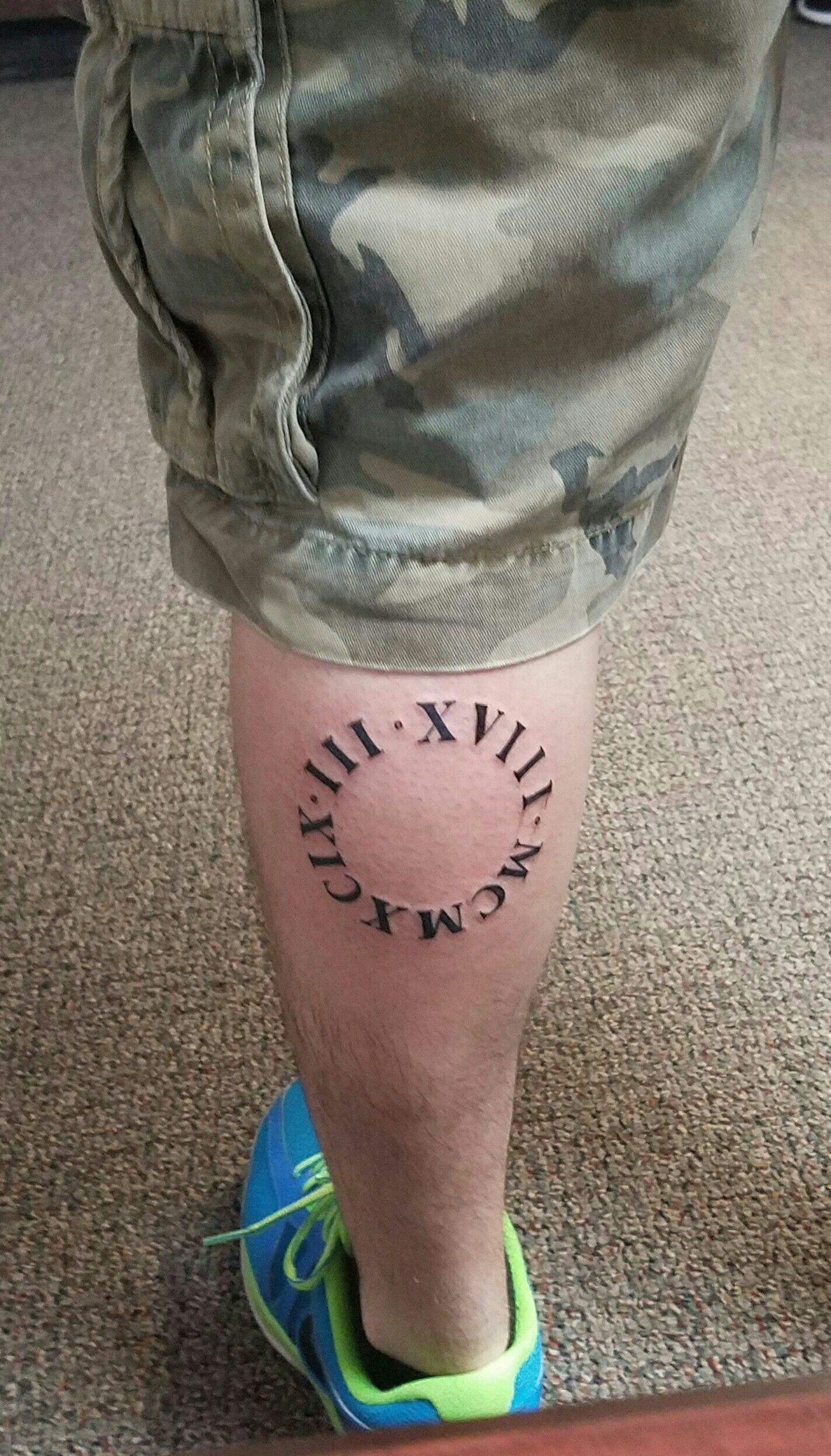 Roman Numeral Circle Calf Anniversary Tattoo