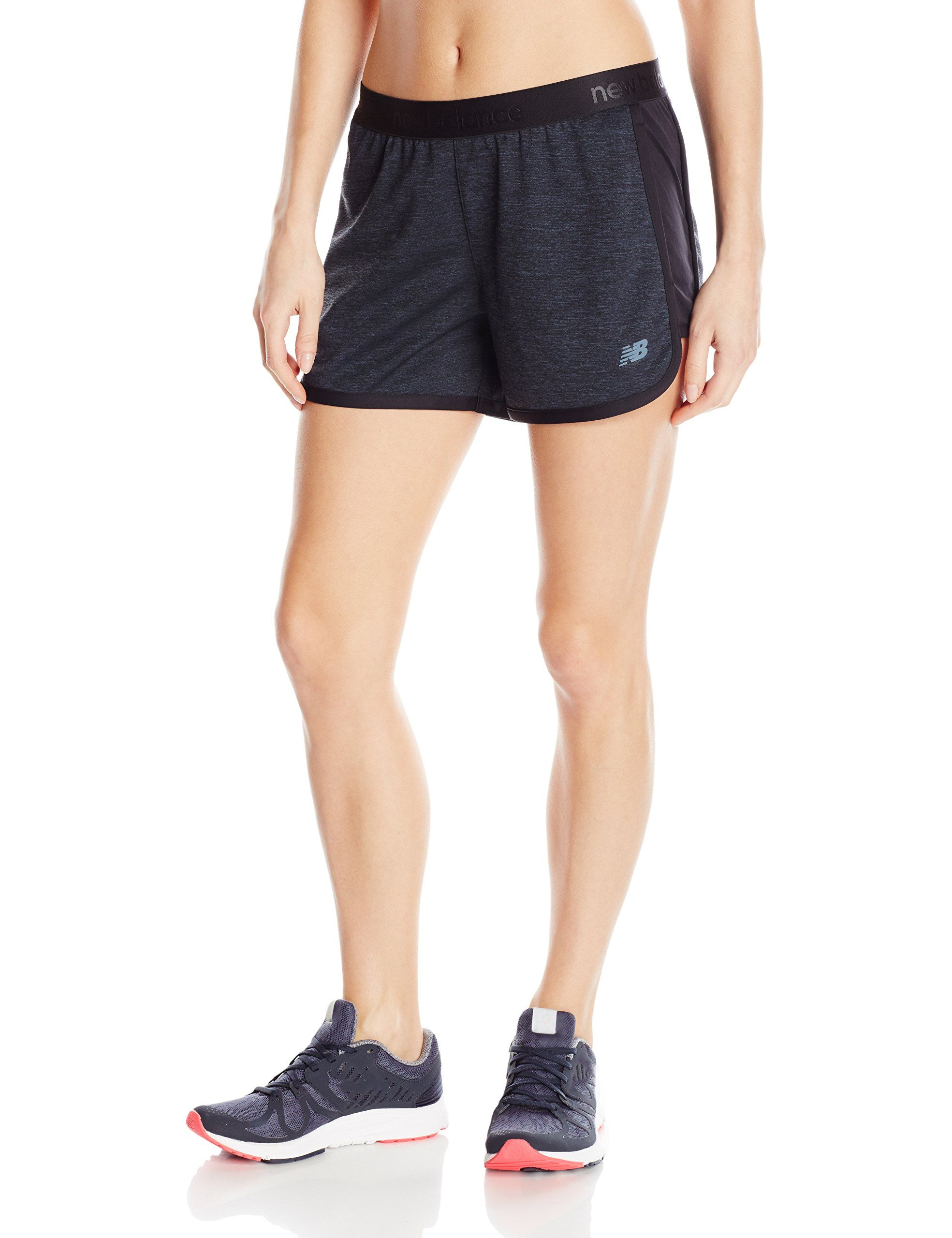 3463ef69cfd93 New Balance Women's Performance Shorts, Black/Grey, Large. Two side texture  Pique. Contrast self binding and insets. Hand pockets. Reflective nb logo.