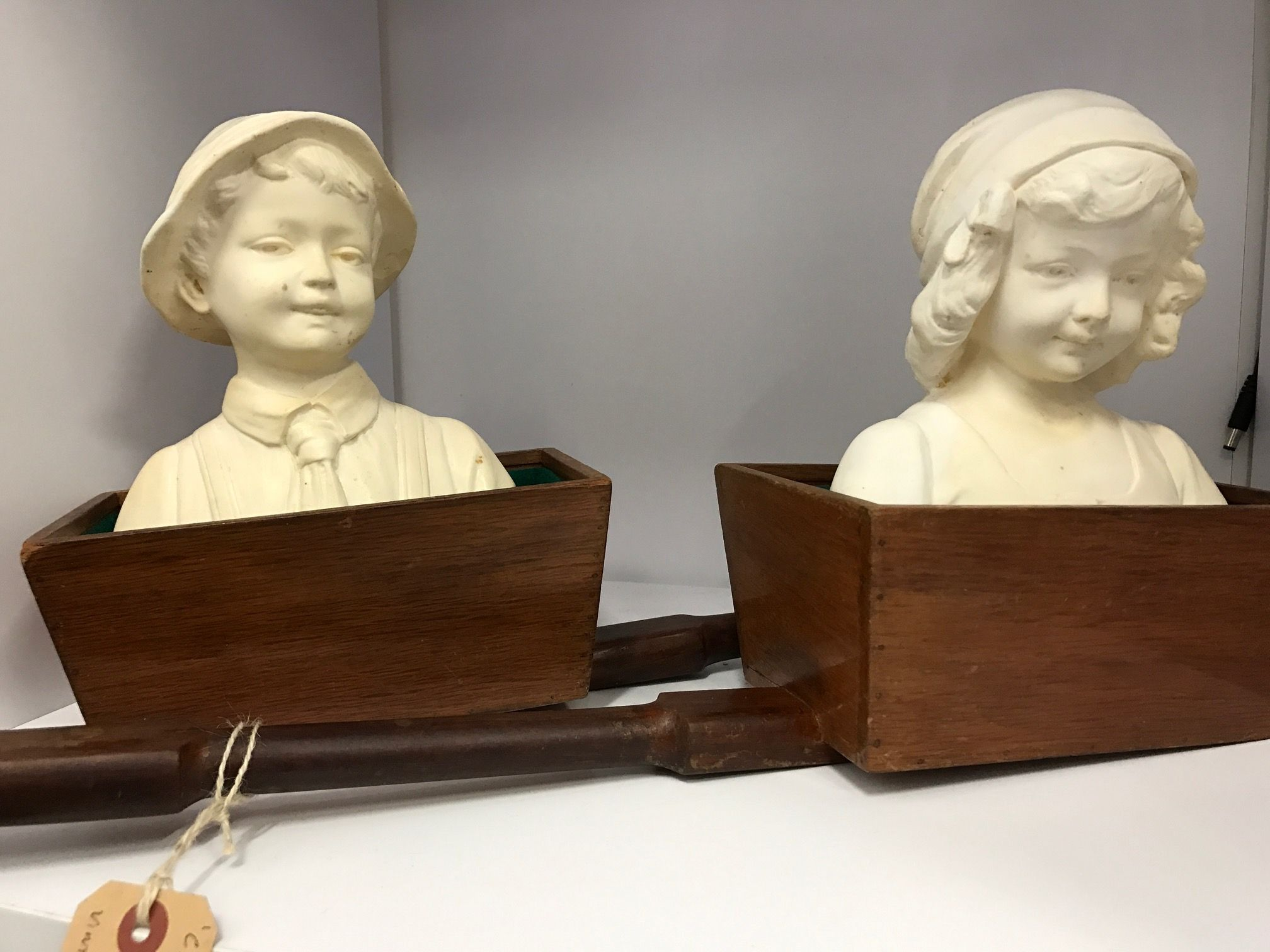 Vint Age Perth has new sculptures in. Childhood, a pair of Vintage busts resting in vintage sheoak giving trays $145